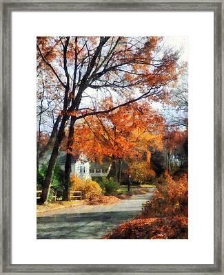 Suburban Street In Autumn Framed Print by Susan Savad