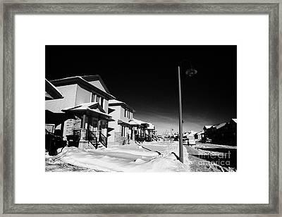 suburbian houses covered in snow during bright crisp winter day Saskatoon Saskatchewan Canada Framed Print