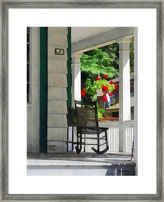 Suburbs - Porch With Rocking Chair And Geraniums Framed Print by Susan Savad