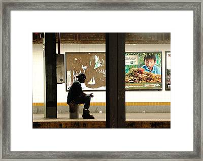 Subway Sitter Framed Print by Mieczyslaw Rudek
