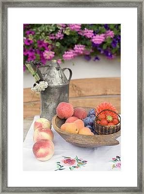 Summer Fruit Still Life On Table In Front Of House Framed Print