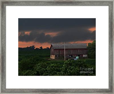 Summer Storm Brewing Framed Print by Laurie Wilcox