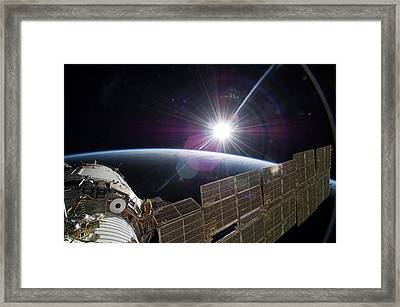Sun And The Iss Framed Print by Nasa