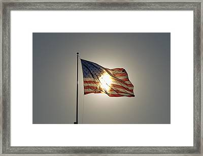 Sun Behind Stars And Stripes Framed Print by Chris Cameron
