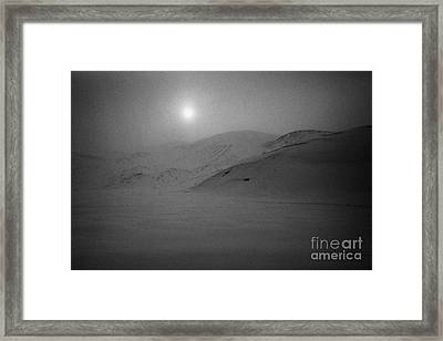 sun breaking through white out snowstorm whalers bay deception island Antarctica Framed Print by Joe Fox