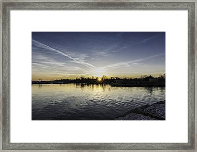 Sun Bursting Through Framed Print by Kris Rowlands