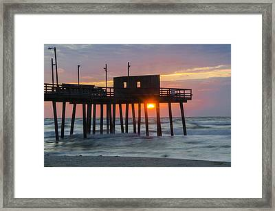 Sun Coming Up Through The 32nd Street Pier  Framed Print by Bill Cannon