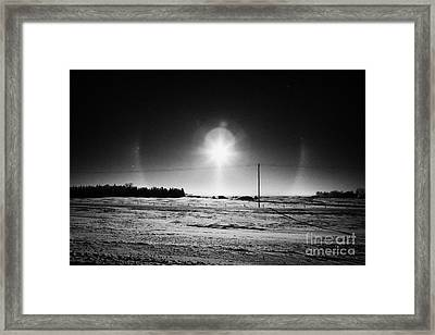 sun dog parhelion halo due to ice crystals surrounding the sun in Saskatchewan Canada Framed Print