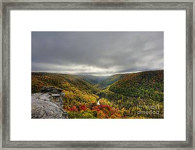 Sun Finding Openings In The Clouds Framed Print by Dan Friend