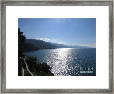 Sun Flare On The Bay Framed Print