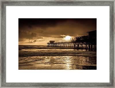 Sun Over The Pier Framed Print