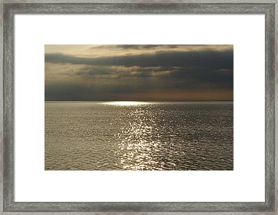 Sun Rays And Reflections In The Sea Framed Print by Gynt