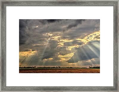 Sun Rays Over A Field Framed Print
