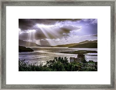 Sun Rays Over Eilean Donan Castle Framed Print