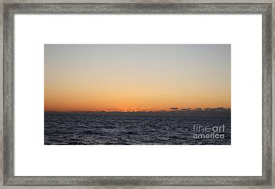 Sun Rising Above Clouds And Horizon Framed Print by John Telfer
