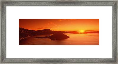 Sun Rising Over Crater Lake National Framed Print by Panoramic Images