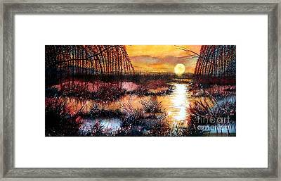 Sun Sets On The Marsh Framed Print by Janine Riley
