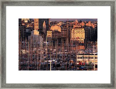 Sun Sets On The Port Framed Print by John Rizzuto