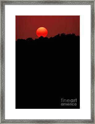 Sun Setting Behind Ridge Framed Print by Mike Nellums