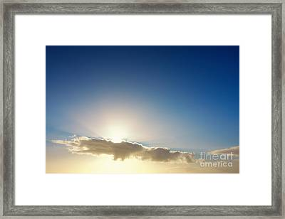 Sunbeams Behind Clouds Framed Print