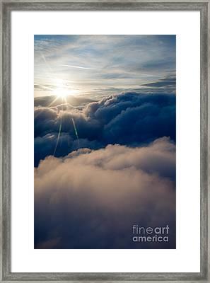 Sunburst Above The Clouds Framed Print