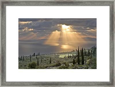 Sunburst Across The Gulf Of Messenia Framed Print by Peter Eastland
