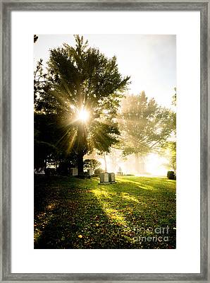 Sunburst Over Cemetery Framed Print by Amy Cicconi