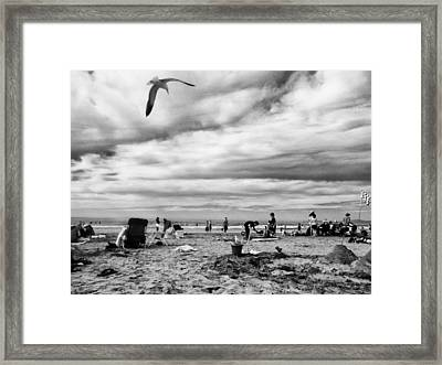 Sunday At The Beach Framed Print by Juan Torrero