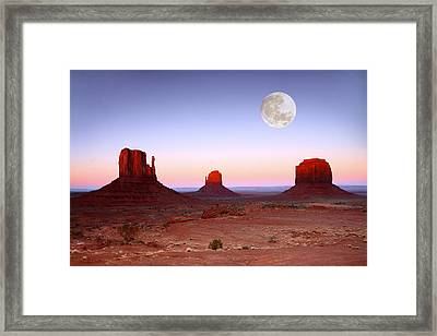 Sundown On The Buttes In Monument Valley Arizona Framed Print by Katrina Brown