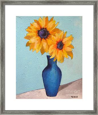Sunflowers In A Blue Vase Framed Print by Venus