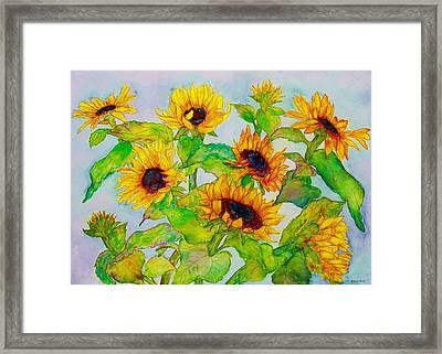 Sunflowers In A Field Framed Print by Janet Immordino