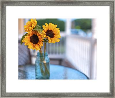 Sunflowers On The Porch Framed Print