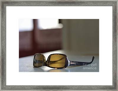 Sunglasses On Table Framed Print