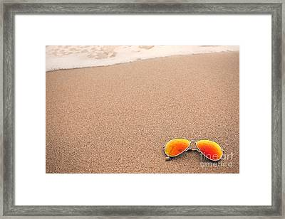 Sunglasses On The Beach Framed Print by Sharon Dominick