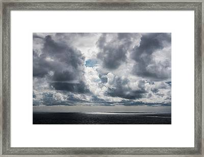 Sunlight Breaks Through The Clouds Framed Print by Robert L. Potts