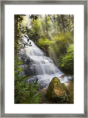 Sunlight On The Falls Framed Print by Debra and Dave Vanderlaan