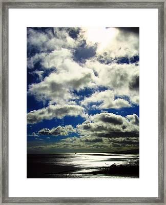 Sunlight Through The Clouds Framed Print