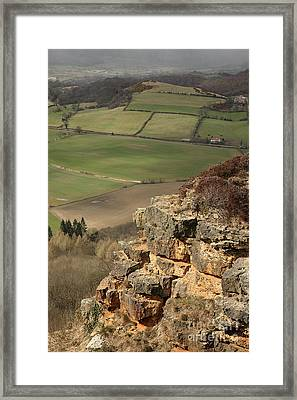 Sunlit Cliff Framed Print by Deborah Benbrook