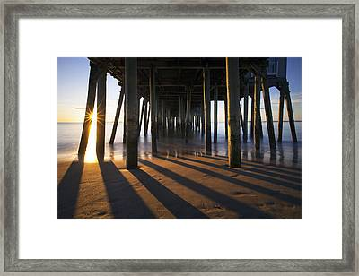 Sunlit Pilings Framed Print by Eric Gendron