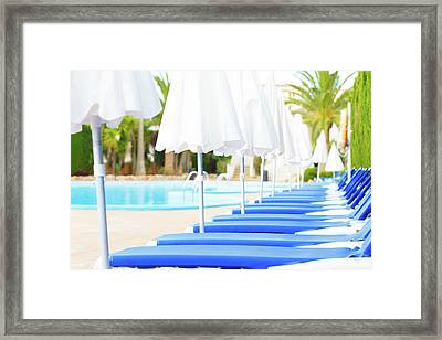 Sunloungers And Parasols In A Row Framed Print by Wladimir Bulgar