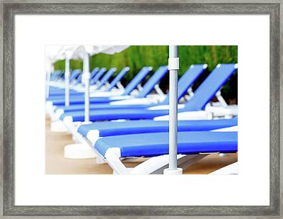 Sunloungers In A Row Framed Print by Wladimir Bulgar