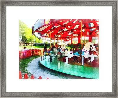 Sunny Afternoon On The Carousel Framed Print by Susan Savad