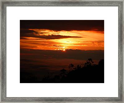 Sunrise Above The Clouds Framed Print by Evan Hendrickson