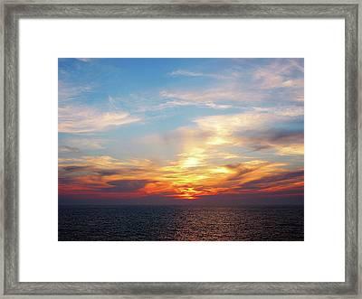 Sunrise At Sea Framed Print by Susan Savad