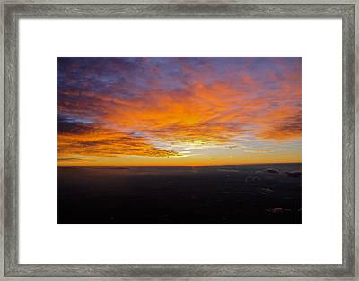 Sunrise From The Airplane Framed Print