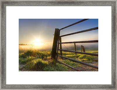 Sunrise  Gate Framed Print by Debra and Dave Vanderlaan