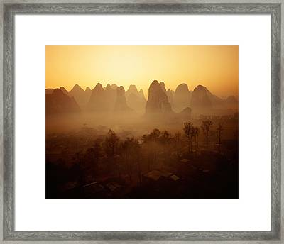 Sunrise In Mountains Guilin China Framed Print by Panoramic Images