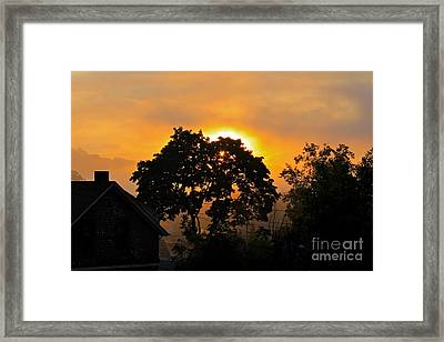 Sunrise Framed Print by Jay Nodianos