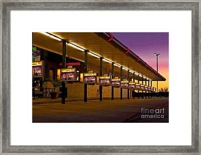 Sunrise On America's Drive-in Framed Print by Robert Frederick