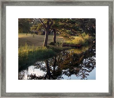 Sunrise On The Bayou Framed Print by John Glass
